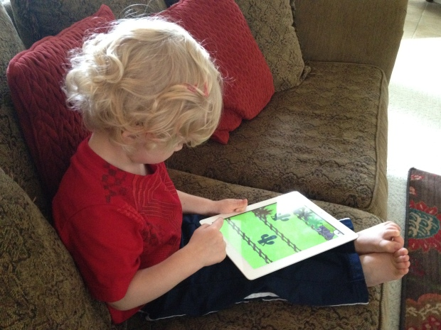 Baby Spawn and his iPad.